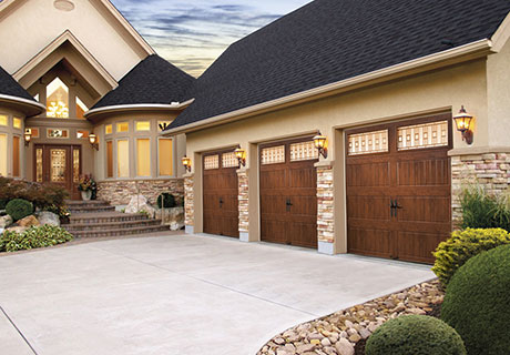 Three Carriage House garage doors