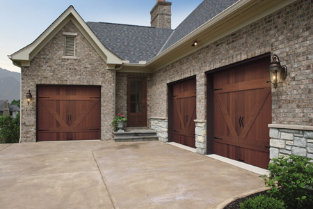 Three brown wooden garage doors